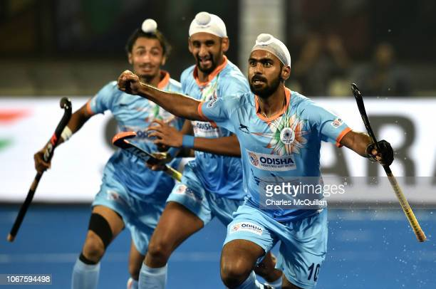 Simranjeet Singh of India celebrates scoring during the FIH Men's Hockey World Cup Group C match between India and Belgium at Kalinga Stadium on...