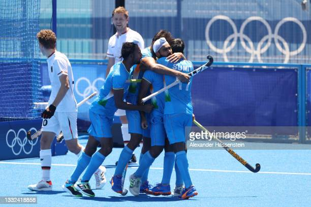 Simranjeet Singh of Team India celebrates scoring their fifth goal with teammates during the Men's Bronze medal match between Germany and India on...