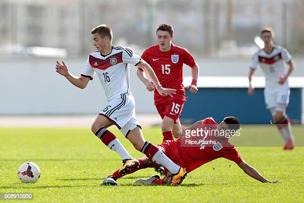 Simranjit Thandi of England challenges Jan Baxmann of Germany during the UEFA Under17 match between U17 England v U17 Germany on February 7 2016 in...