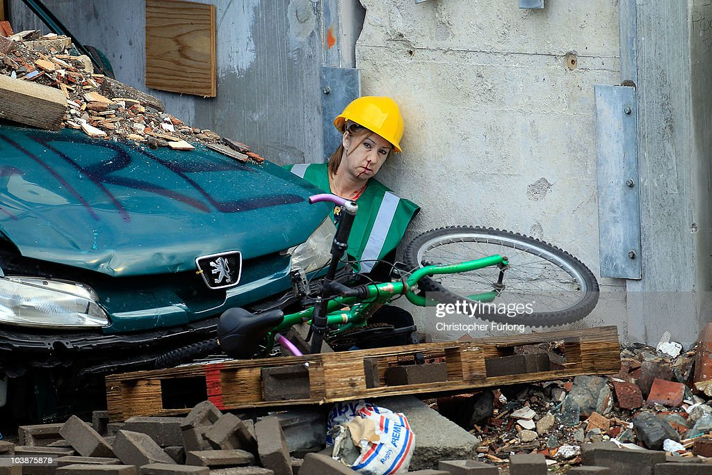 A simulated earthquake casualty waits to be rescued by firefighters from Merseyside Fire Brigade during the UK's biggest ever rescue exercise on September 7, 2010 in Liverpool, England. The National Urban Search & Rescue Exercise simulated an earthquake and involved brigades across the UK. Part of the simulation included vehicles and people trapped in the Mersey Tunnel.