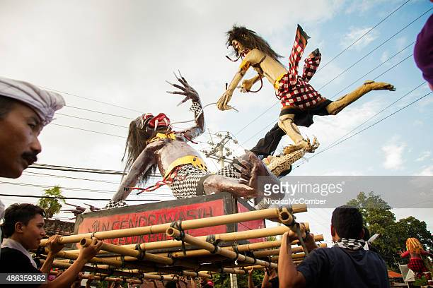 simulated ogre battle during nyepi ngrupuk parade in bali indonesia - melasti stock photos and pictures