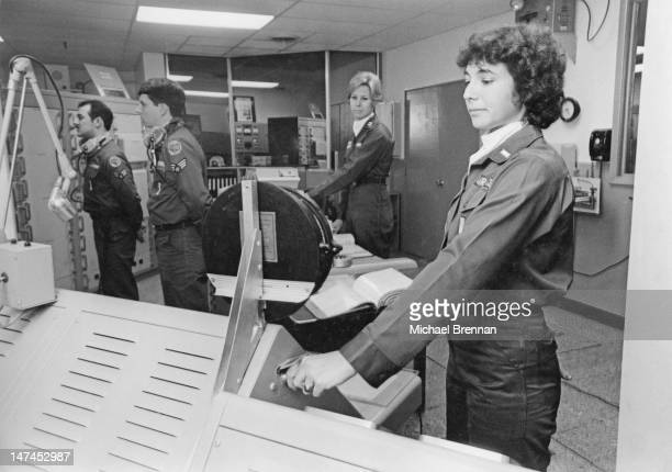A simulation of the launching of a TITAN II ballistic missile at a missile silo near Wichita Kansas 1980 1st Lieutenant Nancy Berger and Captain...