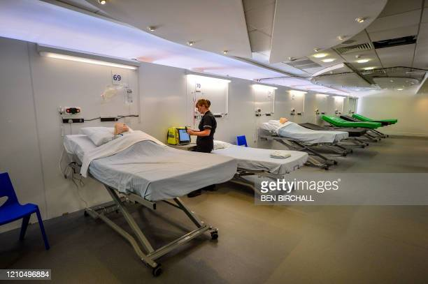 Simulation technician takes part in medical training inside a ward during the official opening of the new Dragon's Heart Hospital, built at the...