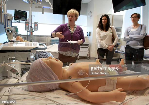 A simulator patient is in the foreground as Kate Donovan demonstrates medical use of Amazon's Alexa voice recognition technology at the Boston...