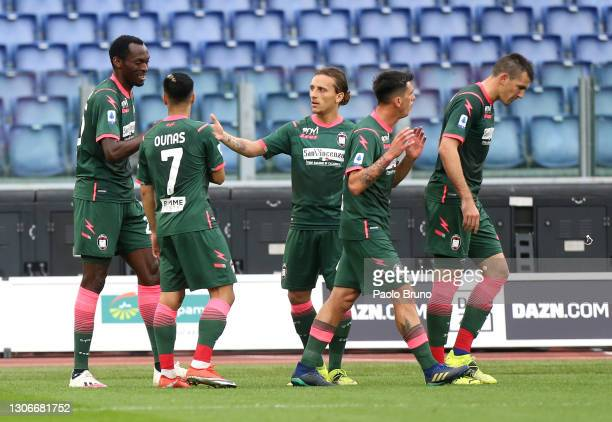 Simy Nwankwo of Crotone celebrates with Adam Ounas and team mates after scoring their side's first goal during the Serie A match between SS Lazio and...