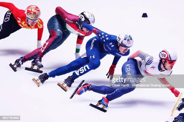 Sin da Woon of Korea and J R Celski United States of America competes in the Men«s 1000m quarter finals race during day two of ISU World Short Track...