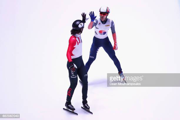 Sin da Woon of South Korea celebrates victory and his gold medal after he competes in the 1500m Mens Final with silver medalist Samuel Girard of...