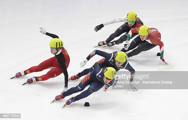 Sin DaWoon of South Korea Charle Cournoyer of Canada Chen Dequan of China and Viktor Knoch of Hungary compete in the Men 1500M Semifinals during the...