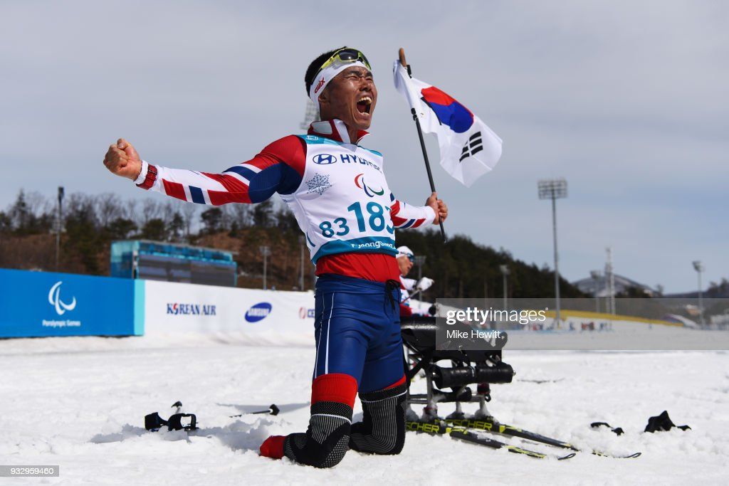 Sin Eui Hyun of South Korea celebrates after winning gold in the Men's Cross Country Skiing 7.5km Sitting on day eight of the PyeongChang 2018 Paralympic Games on March 17, 2018 in Pyeongchang-gun, South Korea.