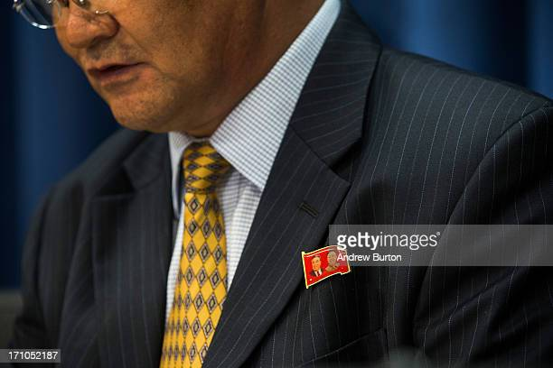Sin Sonho North Korea's Permanent Representative to the United Nations wears a pin displaying the North Korean flag and the portraits of former North...
