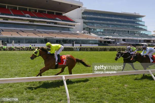 Sin to Win ridden by Luke Currie wins The Macca's Run at Flemington Racecourse on November 03, 2020 in Flemington, Australia.