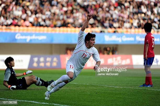 Sina Ashoori Mehrenjani of Iran scores their second goal in the Men's Bronze Medal between South Korea and Iran at Tianhe Stadium during day thirteen...
