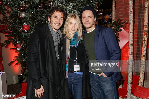 Sina Hentschel Francois Goeske and Daniel Bruehl attend the INTIMISSIMI Christmas Reception on December 09 2015 in Munich Germany