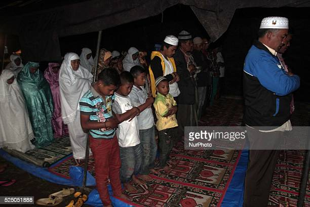 Sinabung volcano refugees tarawih prayers to welcome the holy month of Ramadan which marks the fast with Muslims in the world abstain from food drink...