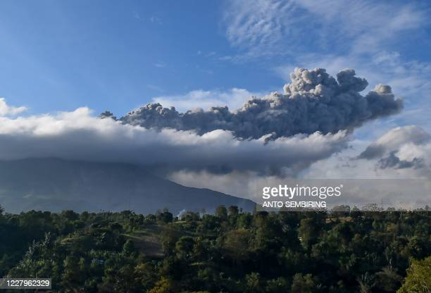 Sinabung volcano spews ash during its second eruption toward dusk as seen from Karo district, North Sumatra, on August 8, 2020.