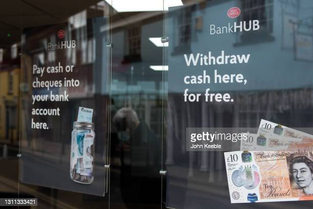Sinage in the window of the new Bank Hub on April 7, 2021 in Rochford, England. The new shared 'Banking Hub' organised by the 'Community Access to...