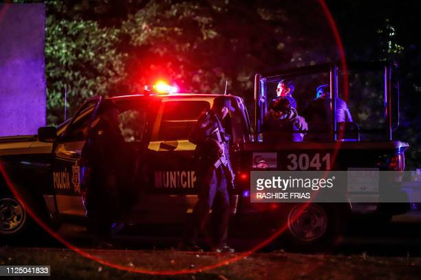 TOPSHOT Sinaloa state police agents stand guard during a security operation in the city of Culiacan Sinaloa state Mexico on February 15 2019 Culiacan...