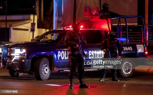Sinaloa state police agents stand guard during a security operation in the city of Culiacan Sinaloa state Mexico on February 15 2019 Culiacan used to...