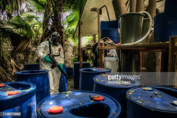 Sinaloa's state police officer works during the dismantle of one of the three clandestine laboratories producers of synthetic drug, mainly...