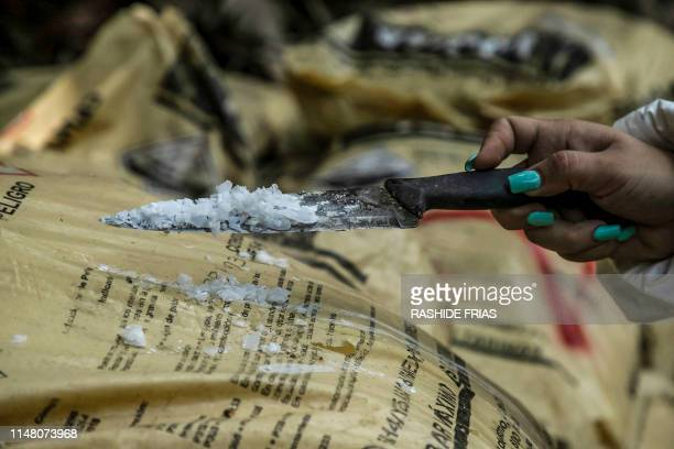 A Sinaloa's state police officer works during the dismantle of one of the three clandestine laboratories producers of synthetic drug mainly...