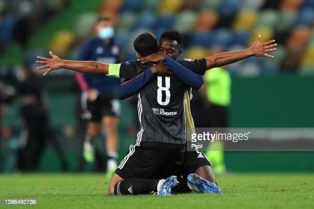 Sinaly Diomande and Houssem Aouar of Olympique Lyon celebrate following their team's victory in the UEFA Champions League Quarter Final match between...