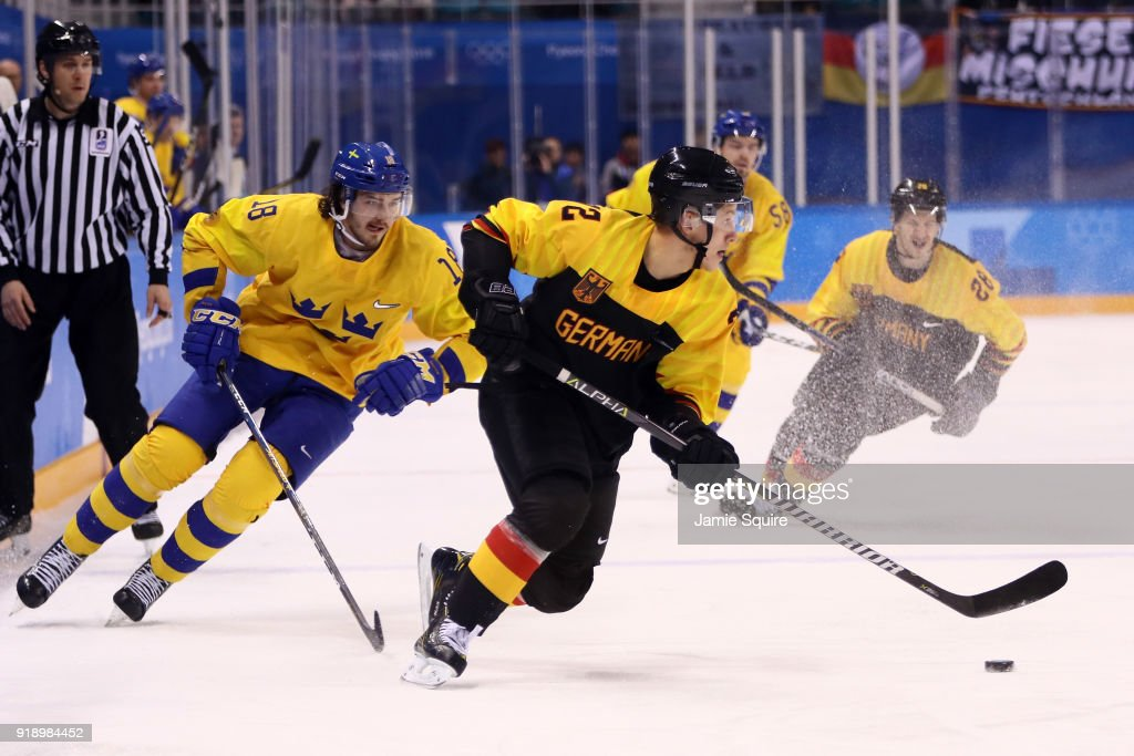 Sinan Akdag #82 of Germany contols the puck against Dennis Everberg #18 of Sweden during the Men's Ice Hockey Preliminary Round Group C game at Kwandong Hockey Centre on February 16, 2018 in Gangneung, South Korea.