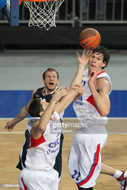 Sinan Guler, #32 of Efes Pilsen Istanbul competes with and Boban Marjanovic, #22 and Nikita Kurbanov, #5 of CSKA Moscow during the Turkish Airlines...