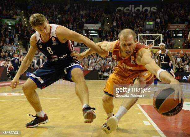 Sinan Guler #32 of Galatasaray Liv Hospital Istanbul competes with Heiko Schaffartzik #8 of FC Bayern Munich during the 20132014 Turkish Airlines...