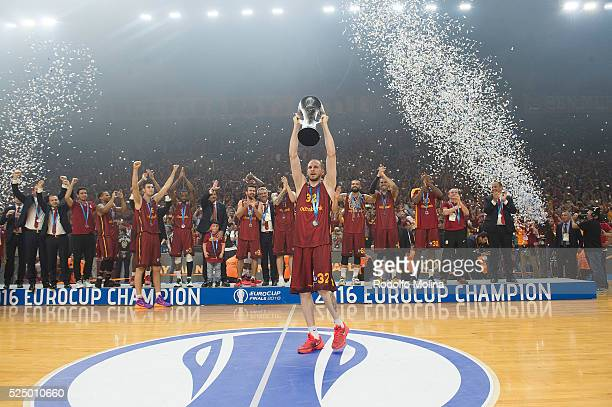 Sinan Guler #32 of Galatasaray Odeabank Istanbul celebrates with teamates at the end of the EuroCup Basketball Finals Game 2 between Galatasaray...