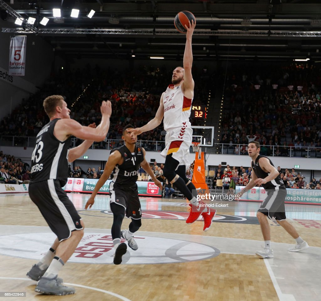 Sinan Guler, #32 of Galatasaray Odeabank Istanbul competes with Vladimir Veremeenko, #14 of Brose Bamberg in action during the 2016/2017 Turkish Airlines EuroLeague Regular Season Round 30 game between Brose Bamberg v Galatasaray Odeabank Istanbul at Brose Arena on April 6, 2017 in Bamberg, Germany.