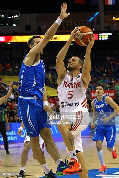 Sinan Guler of Turkey vies for the ball during the FIBA EuroBasket 2015 Group B basketball match between Turkey vs Iceland at Mercedes Benz Arena in...