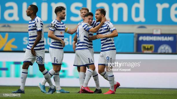 Sinan Karweina celebrates the second goal with Ahmet Engin of Duisburg during the 3 Liga match between MSV Duisburg and SpVgg Unterhaching at...