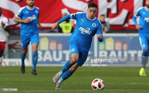 Sinan Karweina of Lotte runs with the ball during the 3 Liga match between FC Energie Cottbus and VfL Sportfreunde Lotte at Stadion der Freundschaft...