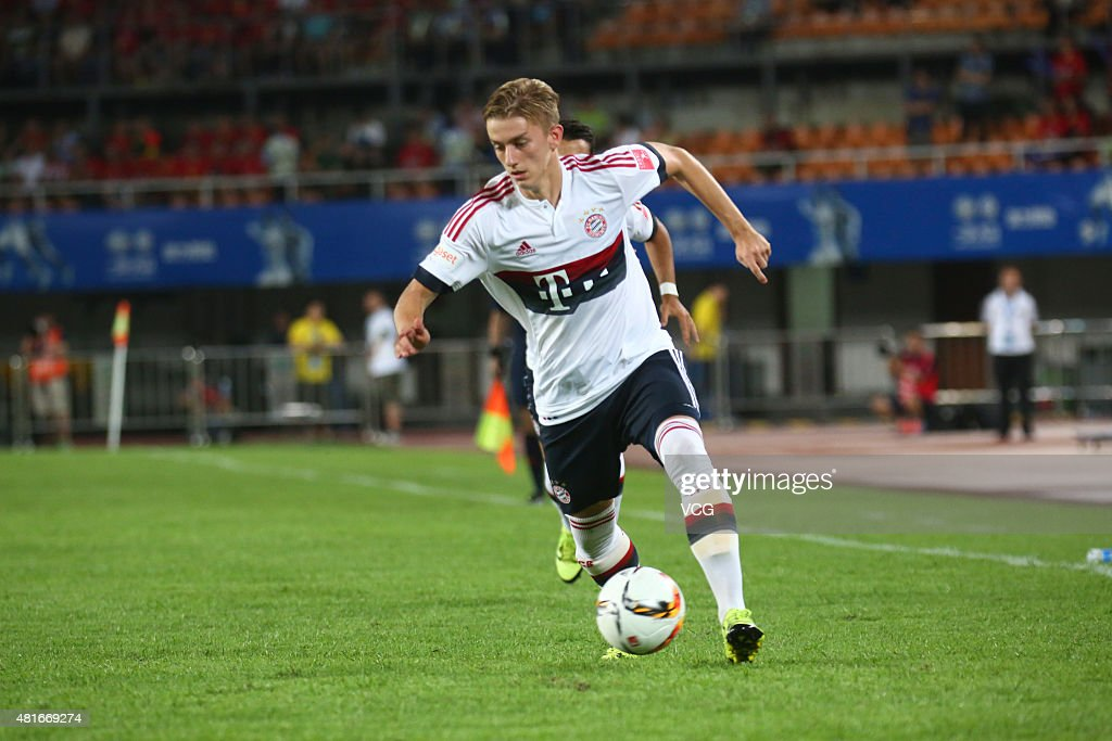Sinan Kurt #24 of FC Bayern Muenchen drives the ball during the international friendly match between Guangzhou Evergrande and FC Bayern Muenchen of the Volkswagen Cup Guangzhou at Tianhe Stadium on July 23, 2015 in Guangzhou, China.
