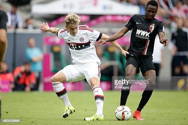 Sinan Kurt of FC Bayern Munchen Abdul Rahman Baba of FC Augsburg during the Telekom Cup friendly match between Bayern Munich and FC Augsburg on July...