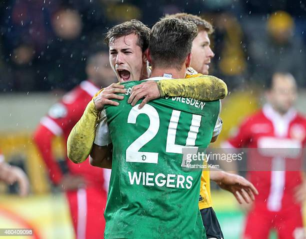 Sinan Tekerci of Dresden and team mate Patrick Wiegers show their delight after winning the third league match between SG Dynamo Dresden and FC...