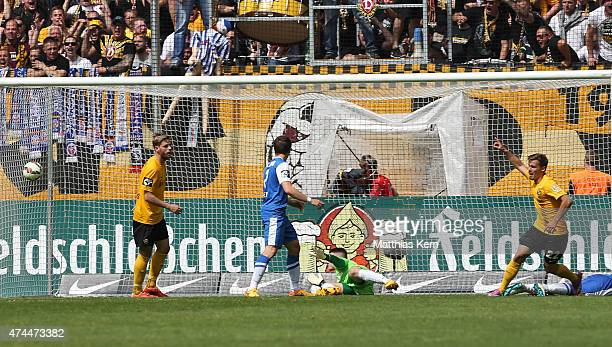 Sinan Tekerci of Dresden scores the third goal during the third league match between SG Dynamo Dresden and FC Hansa Rostock at GluecksgasStadion on...