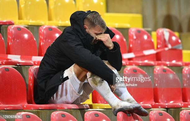 Sinan Tekerci of SV Elversberg looks on dejected after receiving a red card during the DFB Cup second round match between SV Elversberg and Borussia...