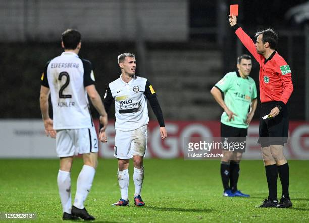Sinan Tekerci of SV Elversberg receives a second yellow resulting in a red card given by referee Marcus Schmidt during the DFB Cup second round match...