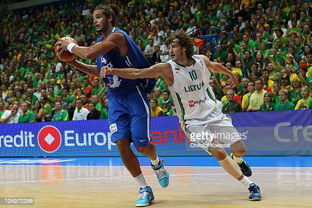 Sinas Jasaitis of Lithuania defends against Joakim Noah of France during the EuroBasket 2011 second round group E match between Lithuania and France...