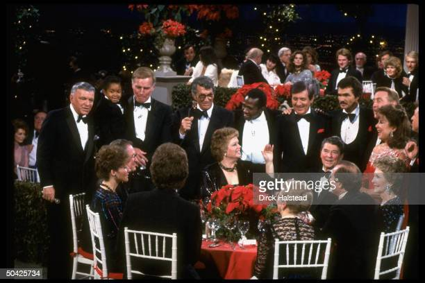 Sinatra, Lewis, Heston, Martin, Vereen, Hall, Reynolds, Scully, Gorme, Lawrence; at table Nancy, Ron & Maureen Reagan & Revell at fete honoring...