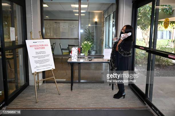 ROCKVILLE MD NOVEMBER Since all visitors are barred from Hebrew Home of Greater Washington Derede McAlpin lets the front desk know that she has...