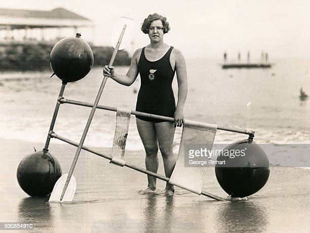Since her successful swimming of the English Channel and being the first woman to have ever accomplished such a feat Gertrude Ederle shown with her...