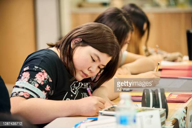 sincere student in classroom - minority groups stock pictures, royalty-free photos & images