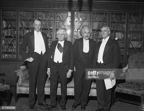 Sinclair Lewis, Frank Kellogg, Albert Einstein, and Irving Langmuir stand together at the Hotel Roosevelt on December 18, 1933. All are Nobel Prize...