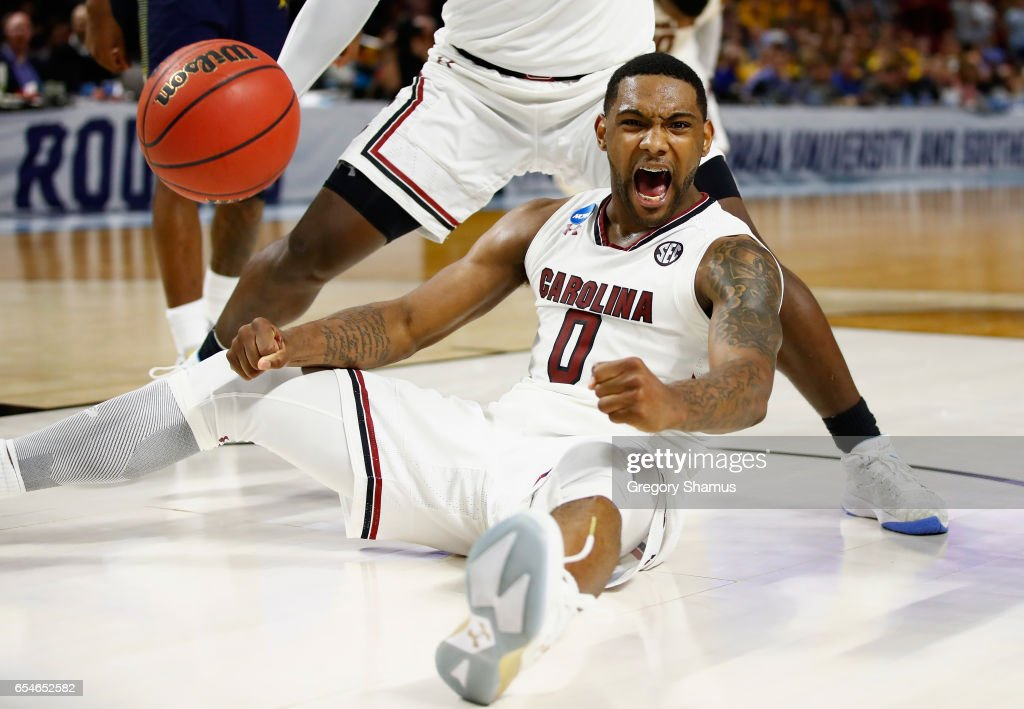 Sindarius Thornwell #0 of the South Carolina Gamecocks celebrates in the second half against the Marquette Golden Eagles during the first round of the 2017 NCAA Men's Basketball Tournament at Bon Secours Wellness Arena on March 17, 2017 in Greenville, South Carolina.