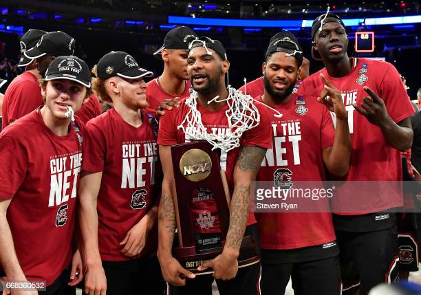 Sindarius Thornwell of the South Carolina Gamecocks holds the trophy with his team after defeating the Florida Gators to win the 2017 NCAA Men's...
