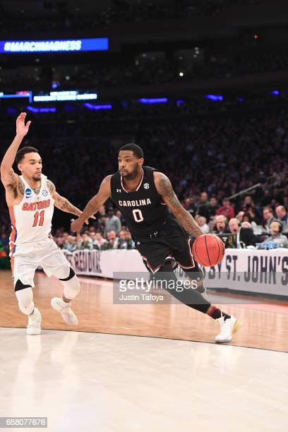 Sindarius Thornwell of the South Carolina Gamecocks is guarded by Chris Chiozza of the Florida Gators during the 2017 NCAA Photos via Getty Images...
