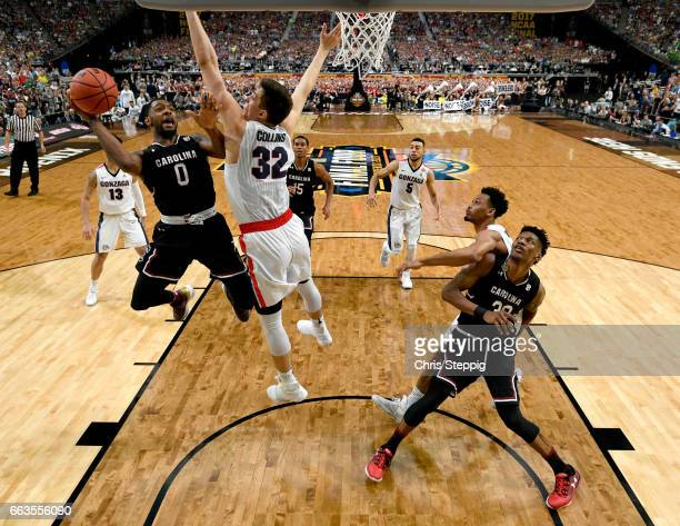 Sindarius Thornwell of the South Carolina Gamecocks looks to shoot the ball over Zach Collins of the Gonzaga Bulldogs during the 2017 NCAA Men's...