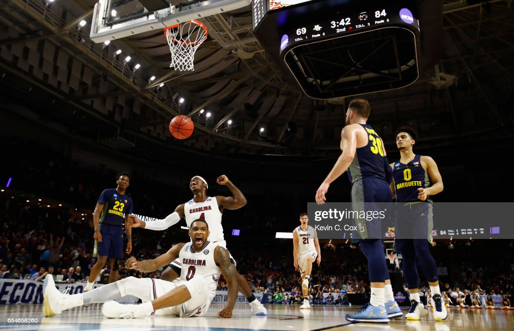 Sindarius Thornwell #0 of the South Carolina Gamecocks reacts to his basket that drew a foul with teammate Rakym Felder #4 against the Marquette Golden Eagles in the second half during the first round of the 2017 NCAA Men's Basketball Tournament at Bon Secours Wellness Arena on March 17, 2017 in Greenville, South Carolina.